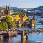 Prague-city-skyline-and-Charles-Bridge-92523139-870x400